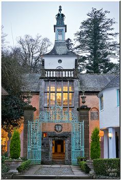 Evening at Portmerion, Gwynedd, Wales I stayed in the Tower a house, the one at… Wales Uk, North Wales, Yorkshire England, Cornwall England, Yorkshire Dales, Beautiful Buildings, Beautiful Places, Port Meirion, Holiday Hotel