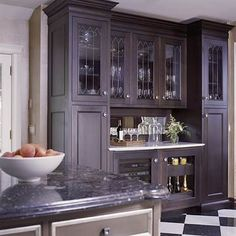 That is clever! mirrored panel backsplash pulls down to cover countertop appliances.  I would love to figure out a way to incorporate something like that in my kitchen.  (hide the blender and Marg, machine)