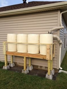 Securing The Home Water Supply With A Simple Rain Barrel Collection System Photo Water Plants, Cool Plants, Rain Barrel System, Rain Barrel Stand, Barris, Water Barrel, Water Collection, Rainwater Harvesting, Water Storage