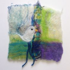 Felt picture with silk fabric and bird