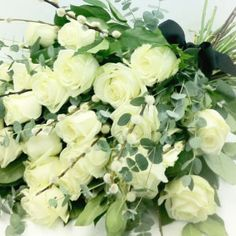 A simple and classic white rose hand-tied sheaf mixed with branches such as pussy willow and eucalyptus.