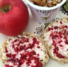 Yummy snack for mommy ❤ Vanilla yogurt topped with ginger snap granola + english muffin smeared with cream cheese & homemade raspberry chia jam + a lovely pink lady apple
