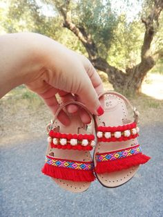 Capri baby and kids leather sandals are comfortable and easy to wear. They are made of high quality Greek handmade leather adorned with red cotton lace, mini red pom poms and acrylic stones cup chain. You can choose the size you prefer scrolling menu on right. Check out Mommy & Me styles: https://www.etsy.com/listing/399143355/mommy-and-me-aloha-sandals-pink-and?ref=shop_home_active_5 100% Greek Leather 100% Handmade Sandals Our Items are handmade and may have slight variations betwe...