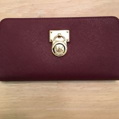 Shop Women's Michael Kors size OS Wallets at a discounted price at Poshmark. Description: Large zip around wallet with interior zipper pocket & room for 10 cards. Merlot.. Sold by brewster51. Fast delivery, full service customer support.