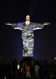 #RIO2016 The Christ is lit with special Led lights by French artist Gaspare Di Caro on the Corcovado hill on August 5 2016 in Rio de Janeiro a few minutes...