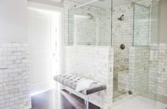 Calcutta Gold marble tiles, shower seat, tufted lucite bench