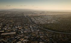 Wide-angle aerial view from the Goodyear blimp shows the California route 405 freeway in the Los Angeles area with the space shuttle Endeavour next to the Randy's Donuts landmark in Inglewood, Calif., Friday, Oct. 12, 2012. Space Shuttle Endeavour Move (201210120014HQ)