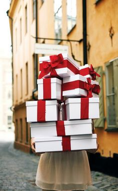 Christmas present wrapping idea: white paper with red bows and red paper with white bows!