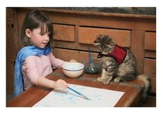 Iris Grace, a 4-year-old girl with autism, who has a beautiful friendship with a therapy cat named Thula. | 19 Kids Who Restored Your Faith In Humanity In 2014