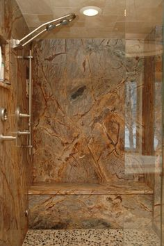 How I would looooove to have a granite slab shower!! NO grout lines to worry about! :)