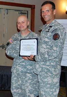LTC Biggerstaff of 532nd MI accepting the award for the 2013 BN Volunteer of the Quarter from COL Conkright on April 16, 2013