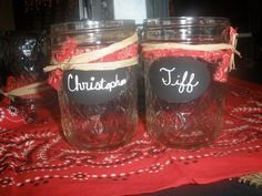 My friend Vera made these for her son's rehearsal dinner. Jelly jars with black board ovals to write the guests names on. So cute!