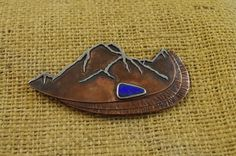 """the """"Three Sisters Brooch"""" Cascade mountains. .925 sterling silver and copper with a boulder opal. By Drew LaVercombe part of my Orographic brooch series"""
