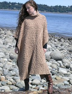 Cabled Poncho by Helen Hamann. Clever construction features diagonal, vertical and horizontal cables with stunning results!