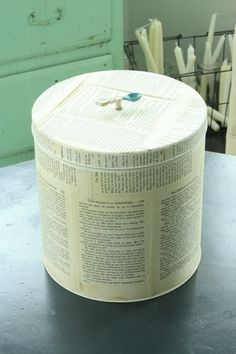 Vintage: An old Holiday tin covered with book pages