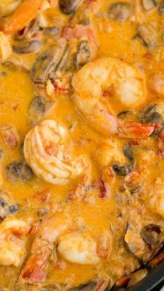 Shrimp & Mushrooms in a Garlic Bisque Sauce ~ luscious, juicy and just succulent. It's great over mashed potatoes, rice or pasta #Shrimps