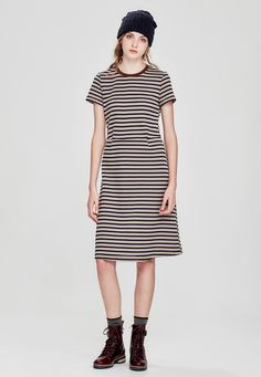 The Preppy knit dress by Sylvester is an easy, flattering a-line shape with a fitted and darted waist, short sleeves and an exposed back zip. Main: 70% Polyester, 30% Cotton. Trim: 100% Polyester. Gentle cool hand wash. Dry cleanable. Model is wearing a size small. Note: This is a pre-order style available for delivery from April 22nd.