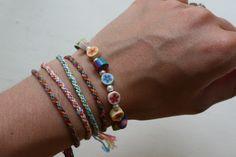 7-strand woven friendship bracelet tutorial using a circular cardboard loom  #handmade #jewelry