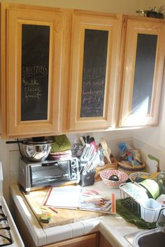 Planning to buy chalkboard contact paper and cover one or two of the cabinets in the kitchen. Easy to put on and remove, and super cute to write on!