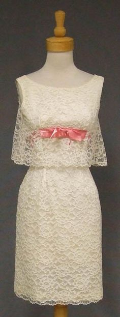 Flirty Ivory Lace 1960's Cocktail Dress w/ Pink Satin $165.00 Product Description A fun and flirty 1960's cocktail dress in ivory nylon lace lined in acetate. Pink satin band with bow. Rear metal zipper.
