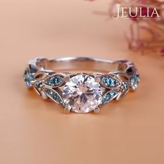 Breathtaking Princess Cut Engagement Rings ❤ Find Your Unique Designer Rings. Be Different. Be Unique. Gorgeous inlay engagement rings, handmade in the US, made just for you. Choose your inlay stone, metal and diamond for a truly unique look. Jeulia Butterfly Round Cut Created White Sapphire with Aquamarine Sidestone Engagement Ring | The Jeulia Jewelry #JeuliaJewelry #princesscutring #princessengagementring #sapphireengagementrings