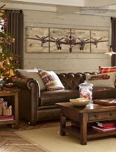 Love the washed knotty pine wall behind the Pottery barn Chesterfield sofa.