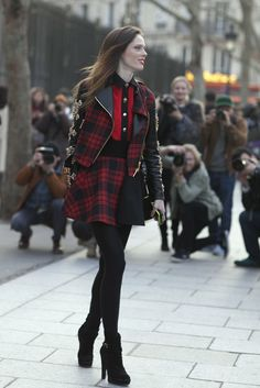 The Best Street Style at Paris Fashion Week: Coco Rocha hit the streets in punk-girl plaid.