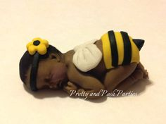 ************* P L E A S E R E A D B E F O R E P U R C H A S I N G*************   You will receive ONE Bumble Bee fondant gumpaste baby with a headband in a clear box decorated with coordinating ribbon. They are edible however would not be recommended due to the fact they dry extremely hard. But will be perfect for display or as a keepsake and will last for months!!! (do not refrigerate) keep in a cool dry place. Different skin tones are available...light, medium and dark Each baby measures…