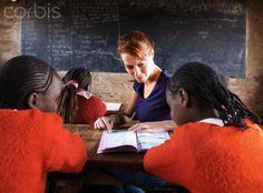 Teacher teaching children in classroom, Kenya