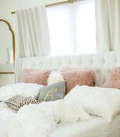 White, light grey, mauve, gold and animal print bedroom decor