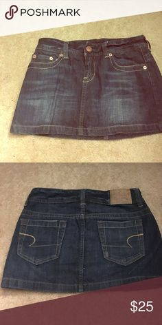 American eagle jean skirt Front pockets with rose colored buttons, back pockets, belt loop...❤️ this dark wash skirt American Eagle Outfitters Skirts Mini