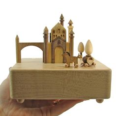 "This unique fine wood crafted music box comes with a miniature horse and carriage that circles around the castle according to variations of the theme from ""Canon in D"". Thanks to its trademark hidden Wooden Music Box, Fun Fair, Wooden Crafts, Musicals, How To Memorize Things, Castle, Miniatures, Circles, Canon"