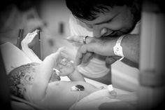 im so in love with this picture my mom did amazing capturing this moment!! here is new daddy and baby right after delivery in a labor and delivery session by sparrow's photography
