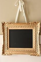 chalk board.  I made a framed chalkboard a while back, will have to add the ribbon and hang it, love it!