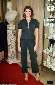 Looking lithe: She looked gorgeous in glittering heels to offset her military green ensemb...