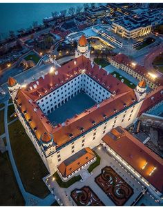 """""""Bratislava now doesn't have anything to prove to anybody,"""" says Vallo. """"The city has a liquid identity that we can shape. Bratislava Slovakia, Blue Hour, Most Beautiful Cities, Amazing Architecture, Hungary, Nova, Places To Visit, Castle, Explore"""