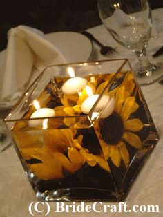 DIY Sunflower centerpieces or could be accent pieces made with silk flowers, but looks very attractive. Step-by-step instructions at: www.bridecraft.com/silk_sunflower_centerpiece.html