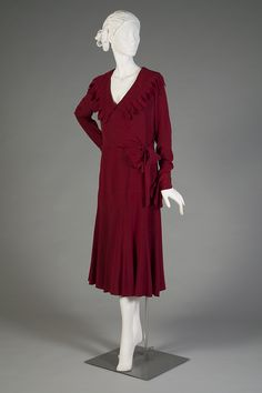 "Day dress of deep red crepe, American, 1930s, KSUM 2003.4.5.  This elegant dress is currently on view in ""Fashion Timeline."""