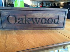 "Custom ""Oakwood"" sign on 2"" barn board. You can custom order your own at designsbypk3.com! You can also find Designs by Pk3 on Etsy!"