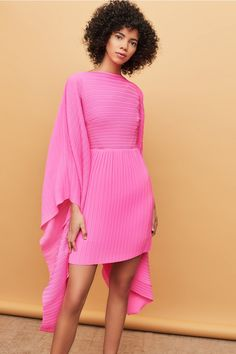 Pleated mini dress with cape sleeves. Signature irregular box plisse pleat Flattering silhouette to skim the body Fitted waist Model is and is wearing a UK size 6 Pink Fashion, Modest Fashion, Runway Fashion, 80s Fashion, Korean Fashion, Fashion Online, Vintage Fashion, Hot Pink Dresses, Lilac Dress