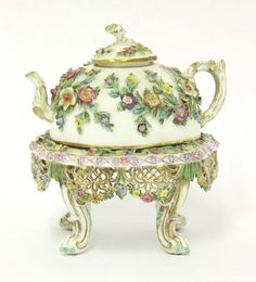 A Meissen floral encrusted teapot and stand, mid 19th century
