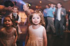 little girl looking at camera at wedding, by Paul Krol