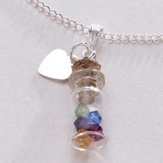 Personalised Birthstones in a bottle necklace. Free engraving on the heart. www.jewels4girls.net