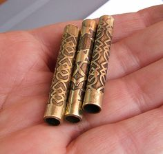 Brass bead tubes - cut, etched, patinated --   by bounty_gg, via Flickr