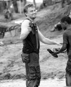 Leonardo DiCaprio lovingly pointing a gun on the set of Blood Diamond