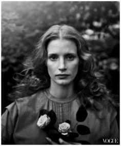 The actress in an image inspired by the work of Julia Margaret Cameron. Band of Outsiders gray smocked dress. Photo by Annie Leibovitz