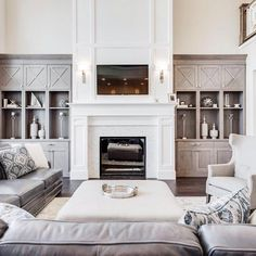➵ Oh man! How about cozying up on comfy plush leather couch in front of that gorgeous marble herringbone tiled fireplace? Built In Around Fireplace, Fireplace Tv Wall, Family Room Fireplace, Fireplace Built Ins, White Fireplace, Fireplace Remodel, Fireplace Design, Two Story Fireplace, Fireplace Ideas