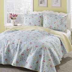 Bring a romantic look to any bedroom with the Laura Ashley reversible cotton quilt set. Constructed of 100-percent cotton, the quilt showcases a floral design in a blue, yellow, red, green and purple finish.