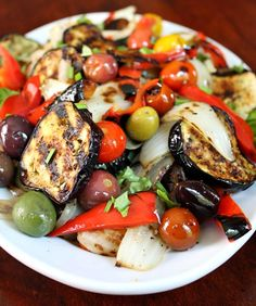 This grilled vegetable salad recipe is composed of sweet grilled vegetables tossed in a light dressing. Lovely summer recipe.