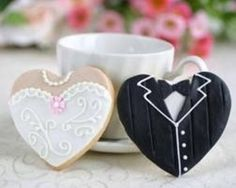 """Wedding Food boda - Tastefully hand-decorated, the Heart Shaped Dress and Tux Cookies are sure to be regarded the ultimate in edible favors; what a sweet-""""hearted"""" reminder of your Big Day! Cookie Wedding Favors, Cookie Favors, Unique Wedding Favors, Unique Weddings, Wedding Desserts, Wedding Gifts, Wedding Souvenir, Wedding Cupcakes, Cookie Desserts"""